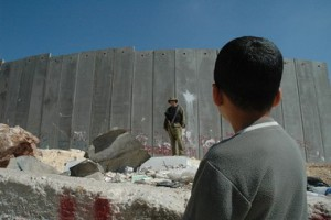 a_boy_looking_at_an_israeli_soldier