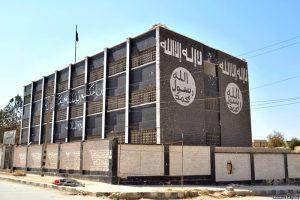 Mur en Syrie avec le drapeau de Daech