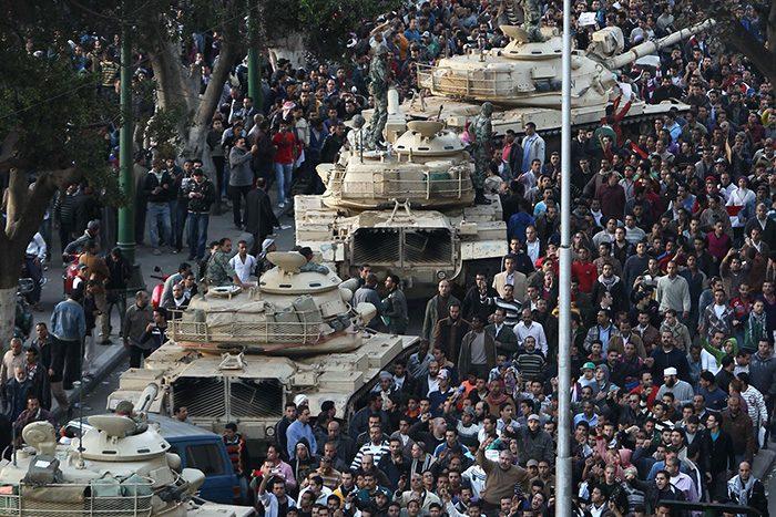 Egyptian demonstrators demanding the ouster of President Hosni Mubarak gather around Egyptian army tanks deployed in Cairo on January 29, 2011. AFP PHOTO/KHALED DESOUKI (Photo by KHALED DESOUKI / AFP)